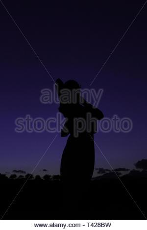 person in silhouette - Stock Photo