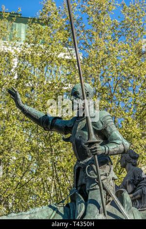Bronze sculpture of Don Quixote of Monument to Miguel de Cervantes Saavedra in Plaza de España, Madrid, Spain - Stock Photo