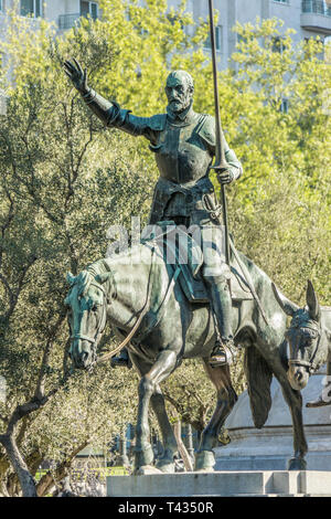 Bronze sculpture of Don Quixote in Stone Monument to Miguel de Cervantes Saavedra at Plaza de España, Madrid, Spain - Stock Photo