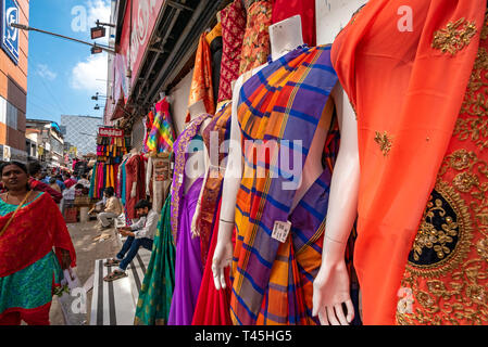 Horizontal streetview of a busy shopping precinct in Chennai, India. - Stock Photo