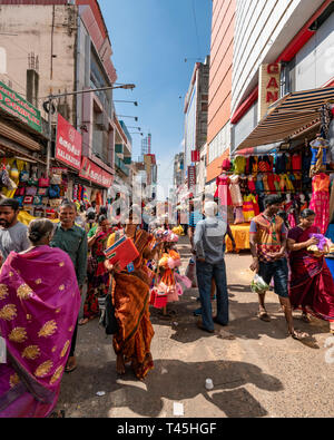 Vertical streetview of a busy shopping precinct in Chennai, India. - Stock Photo
