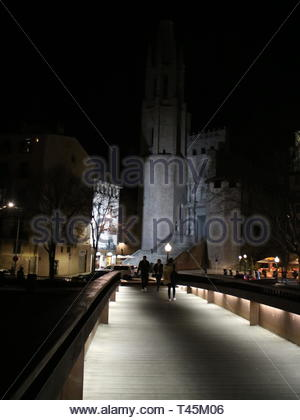 Night photo of the Pont De Felix with the Basilica in Girona Spain - Stock Photo