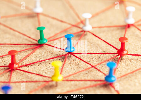 Business team. Connect between people. Office pins connected by red thread. - Stock Photo