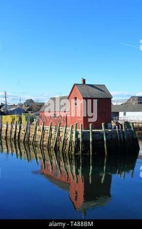Pier with red fishing shack known as Motif Number One in Rockport, Massachusetts - Stock Photo