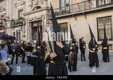 Madrid, Madrid, Spain. 14th Apr, 2019. Penitents seen dressed in black during the processions of Palm Sunday.The Organization for the Sacramental Brotherhood and Brotherhood of Nazarenes of the Most Holy Christ of Faith and Forgiveness, Mary Most Holy Immaculate Mother of the Church and Archangel Michael. Credit: Alberto Sibaja/SOPA Images/ZUMA Wire/Alamy Live News - Stock Photo