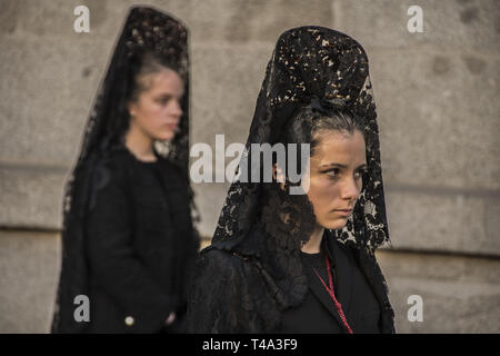 Madrid, Madrid, Spain. 14th Apr, 2019. Women dressed in black seen during the processions of Holy Week of Palm Sunday.The Organization for the Sacramental Brotherhood and Brotherhood of Nazarenes of the Most Holy Christ of Faith and Forgiveness, Mary Most Holy Immaculate Mother of the Church and Archangel Michael. Credit: Alberto Sibaja/SOPA Images/ZUMA Wire/Alamy Live News - Stock Photo