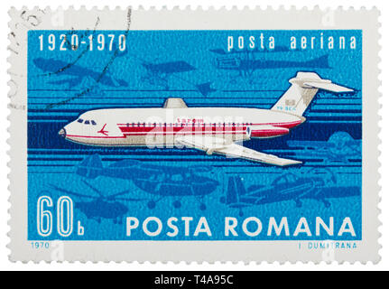 ROMANIA - CIRCA 1970: Stamp printed in Romania shows image of the flying jet plane, symbol of air mail, circa 1970 - Stock Photo