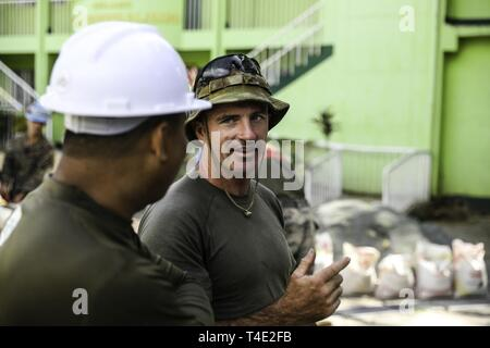 Australian Army Pvt. James McLennan discusses operations with Philippine Army Capt. Alger Depositario, the project officer, at Victor O' De Guia Jr. Memorial Elementary School in Balian, Pangil, Laguna, Philippines, March 27, 2019, as part of Exercise Balikatan. Marines with Engineer Company A, 9th Engineer Support Battalion, 3rd Marine Logistics Group, are working shoulder-to-shoulder with the Armed Forces of the Philippines and Australian Defence Force to build a classroom. Balikatan, in its 35th iteration, is an annual exercise between the U.S. military and the Armed Forces of the Philippin - Stock Photo