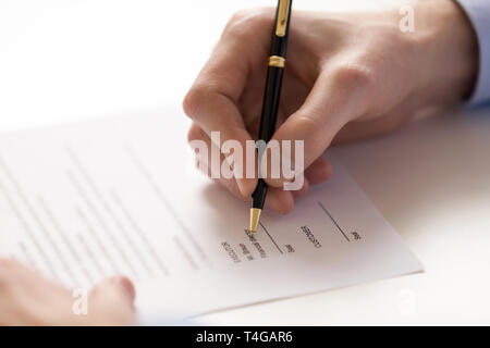 Signing document under business contract agreement at fountain pen - Stock Photo