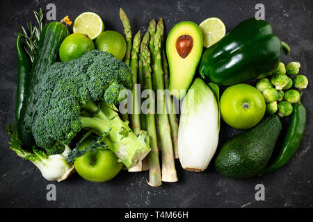 Variety green vegetables and fruits. Healthy food vegetables and fruits, dieting, clean eating, detox concept. Top view - Stock Photo