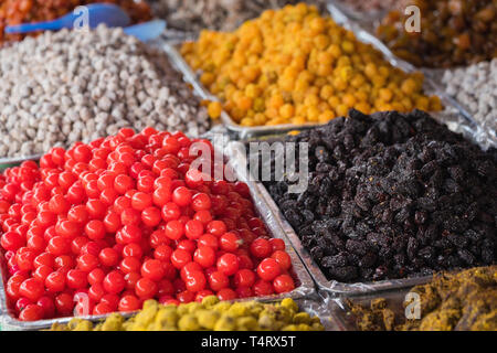 Colorful dried salted or sugared Asian tropical fruits - Stock Photo