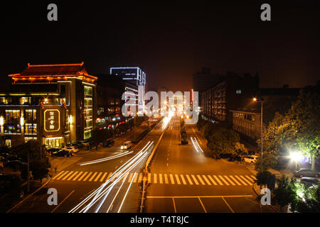View on the night traffic with lights effects in Xian, China - Stock Photo