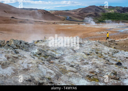 Hot springs in Namaskard geothermal area also called Hverarond near Reykjahlid, Iceland, view with Namafjall mount - Stock Photo