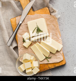 Block of butter on board - Stock Photo