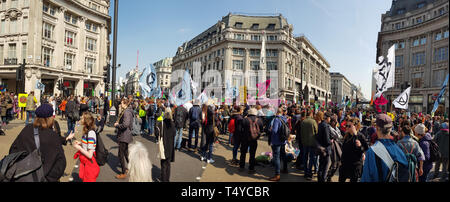 London, United Kingdom, April 15th 2019:- Extinction Rebellion protesters block in Oxford Circus in central London to protest the current environmenta - Stock Photo