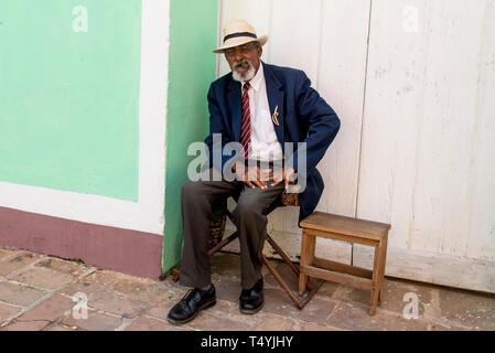 Elderly man with hat and beard smoking cigar in Trinidad, Cuba. Photo taken on 3rd of November, 2019 - Stock Photo