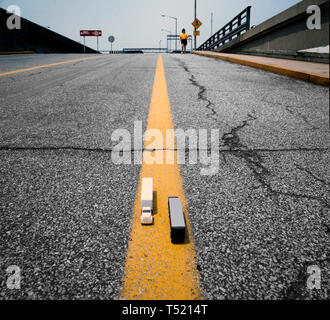 model truck on a real road - Stock Photo