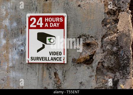 CCTV camera sign video surveillance in public park - Stock Photo