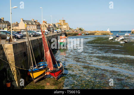 Barfleur, France - August 29, 2018: Low tide in the harbor of Barfleur, Normandy France - Stock Photo