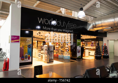 Bournemouth Airport departure hall interior World of Duty Free shop - Stock Photo
