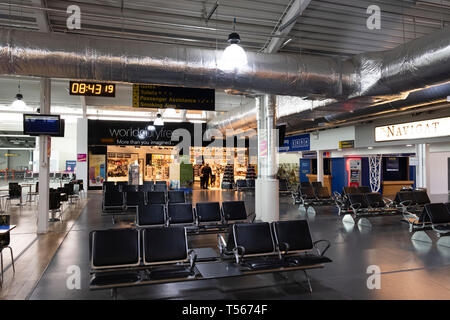Bournemouth Airport departure hall with empty seats interior - Stock Photo