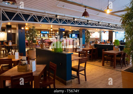 Bournemouth Airport departure hall interior empty restaurant - Stock Photo