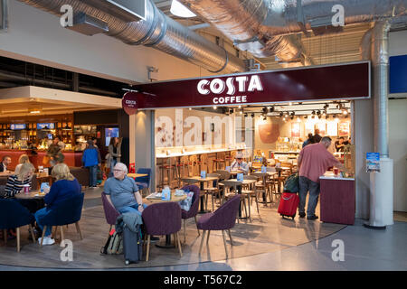 Bournemouth Airport departure hall interior passengers at Costa Coffee shop - Stock Photo
