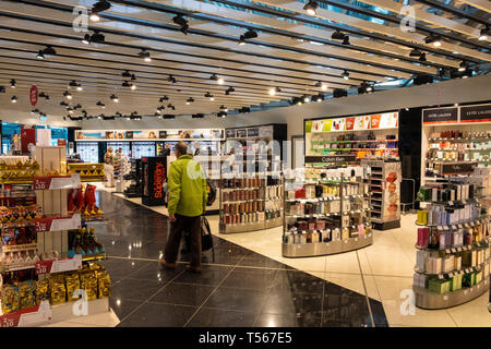 Bournemouth Airport departure hall interior world of Duty Free shop interior with dispaly stands - Stock Photo