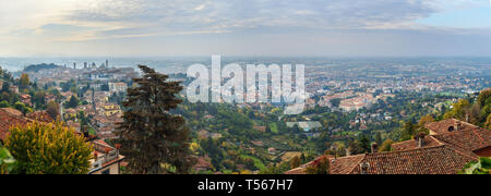 Panorama View of Bergamo Upper and Lower city from Saint Vigilio hill in morning. Italy - Stock Photo