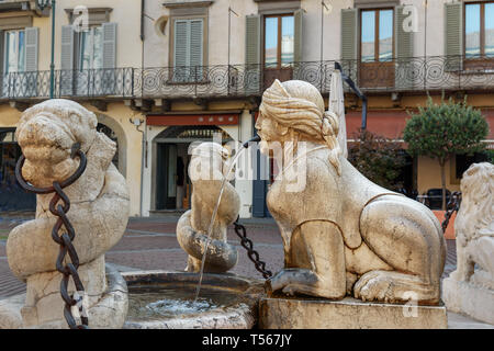 Venetian Contarini fountain on Piazza Vecchia in Bergamo. Italy - Stock Photo