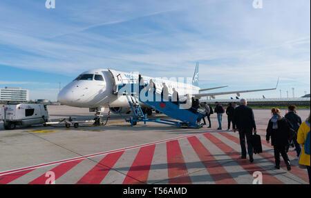 Paris, France - April 5, 2019: plane Embraer ERJ-195LR 4O-AOA of montenegro airlines at Charles de Gaulle Airport - Stock Photo