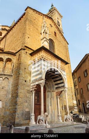 Porta dei Leoni Bianchi on the right transept of Basilica of Santa Maria Maggiore in Bergamo. Italy - Stock Photo