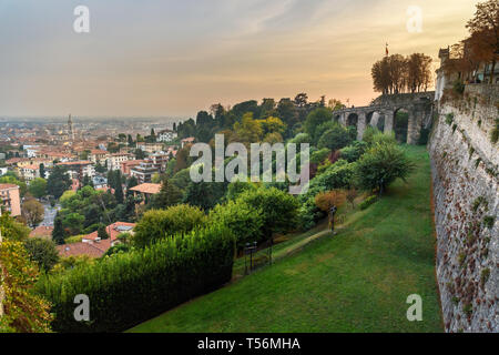 View of Bergamo city from Sant Andrea platform at sunset. Italy - Stock Photo
