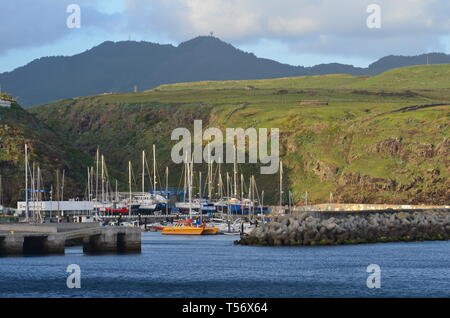 Yachts moored at the marina of Vila do Porto, administrative centre of Santa Maria island, Azores - Stock Photo