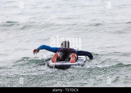 Bournemouth, Dorset, UK. 22nd Apr, 2019. UK weather: after a hazy start the glorious weather continues with hot and sunny weather, as beachgoers head to the seaside to enjoy the heat and sunshine at Bournemouth beaches on Easter Monday before the weather changes and the return to work. Paddleboarder paddle boarder. Credit: Carolyn Jenkins/Alamy Live News - Stock Photo