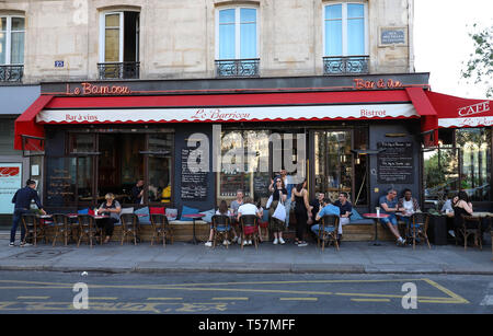 The traditional french cafe Barricou located on Beaumarchais boulevard , Paris, France. - Stock Photo