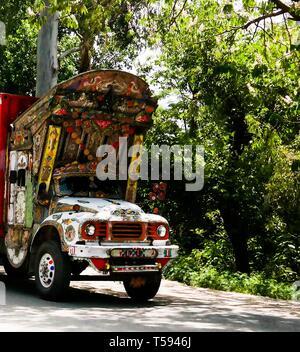 Decorated truck at the road - 07 may 2015 Karakoram highway, Pakistan - Stock Photo