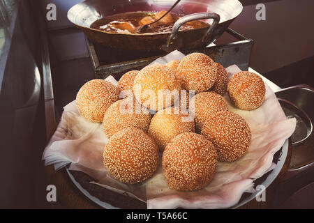 Traditional vietnam fried ball dessert bean selling in the street in Danang - Stock Photo