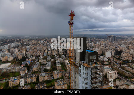 Netanya, Center District, Israel - March 31, 2019: Aerial view of a construction site in a city during a cloudy sunrise. - Stock Photo