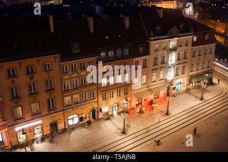 Poland, city of Warsaw at night, historical tenement houses on Krakowskie Przedmiescie street, view from above - Stock Photo