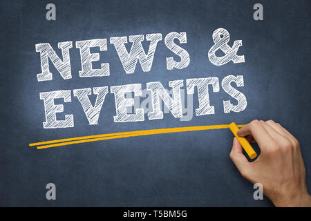 hand writing chalk text on blue chalkboard - news and events - Stock Photo