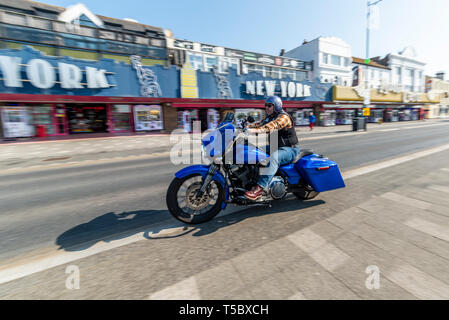 Custom motorcycle at Southend on Sea, Essex, seafront on a sunny day. Amusement arcades on Marine Parade. Space for copy - Stock Photo