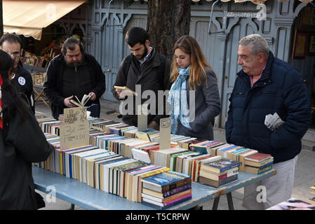Madrid, Madrid, Spain. 23rd Apr, 2019. People are seen reading books at the Cuesta de Moyano street in Madrid during the World Book Day.World Book Day is celebrated all over the world. The specific date was chosen by the Spanish booksellers to honour the author Miguel de Cervantes, who died on April 22nd in 1616. Credit: John Milner/SOPA Images/ZUMA Wire/Alamy Live News - Stock Photo