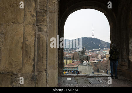 Tbilisi, Georgia - Mart 21 2019: Metekhi Church of Assumption and Vakhtang Gorgasali monument on the top of the rock on the bank river Kurain Tbilisi - Stock Photo