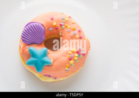 Donut on a white plate, donut with white background - Stock Photo