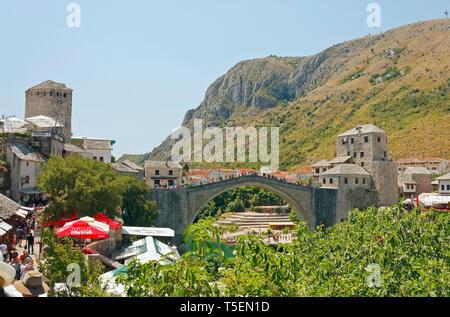 Stari Most; Old Bridge; 16 century Ottoman bridge over River Neretva; arched design; narrow street, people, UNESCO World Heritage site; Mostar; Bosnia - Stock Photo