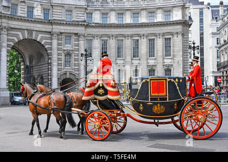 Horse drawn State Landau carriage move towards  Admiralty Arch with coachman & footman in uniform after transporting diplomatic dignitaries London UK - Stock Photo