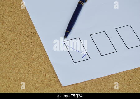 pen filled correct sign in the blank on white paper - Stock Photo