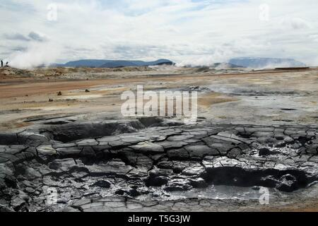 Seltun / Krysuvik (Krýsuvík) - Bubbling hot mud pot on steaming geothermal field with deposits of sulfates - Stock Photo