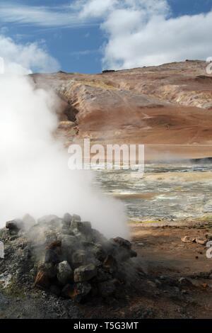 Seltun / Krysuvik (Krýsuvík): Steaming fumarole on geothermal field with yellow deposits of sulfates - Stock Photo